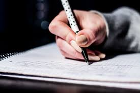 womans hand writing